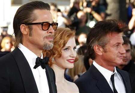 Brad Pitt, Jessica Chastain and Sean Penn pose as they arrive for the screening of ''The Tree of Life'' by director Terrence Malick, in competition at the 64th Cannes Film Festival, May 16, 2011. REUTERS/Vincent Kessler