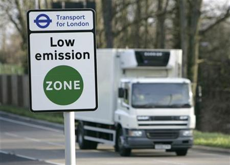 A vehicle passes a sign for the new Low Emissions Zone at Coulsdon in London February 3, 2008. REUTERS/Luke MacGregor