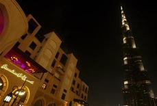 <p>The world's tallest structure Burj Khalifa is seen next to Souk Al Bahhar (L) in Dubai April 1, 2011. REUTERS/Jumana El-Heloueh</p>