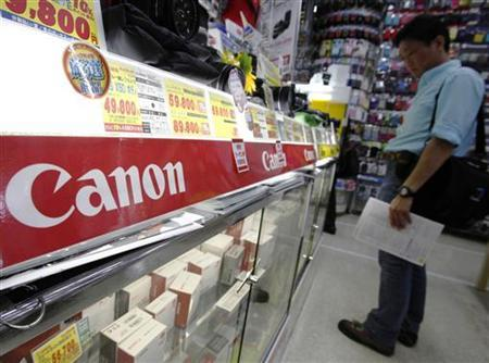 Canon camera equipment is displayed at an electronic shop in Yokohama, south of Tokyo in this April 26, 2011 file photo. REUTERS/Yuriko Nakao