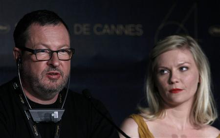 Director Lars Von Trier (L) and cast member Kirsten Dunst attend a news conference for the film ''Melancholia'', in competition at the 64th Cannes Film Festival, May 18, 2011. REUTERS/Yves Herman