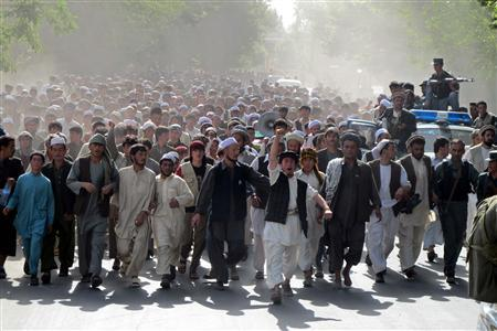 Afghans chant slogans as they protest the killing of four people overnight after a raid by NATO and Afghan forces, in Taloqan, May 18, 2011. REUTERS/Stringer