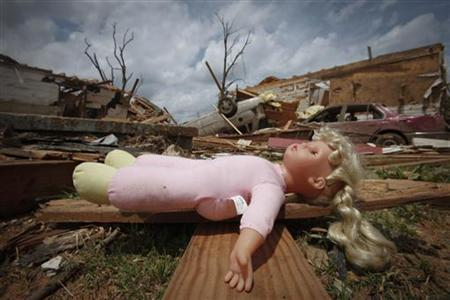A child's doll sits among the ruins of homes badly damaged in April 27's deadly tornados in Tuscaloosa, Alabama May 2, 2011. REUTERS/Lee Celano