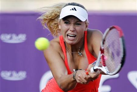 Caroline Wozniacki of Denmark plays a backhand to Varvara Lepchenko of the U.S. during the second round of the WTA Brussels Open tennis tournament in Brussels May 18, 2011. REUTERS/Francois Lenoir