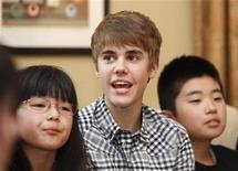 <p>Canadian pop star Justin Bieber is flanked by children from northeastern Japan, the area devestated by the March 11 earthquake and tsunami, during an event at the U.S. Ambassador's residence in Tokyo May 18, 2011. REUTERS/Yuriko Nakao</p>