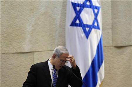 Israel's Prime Minister Benjamin Netanyahu gestures as he speaks during the opening of the summer session of the Knesset, the Israeli parliament, in Jerusalem May 16, 2011. REUTERS/Ronen Zvulun