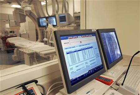 A monitor in the control room displays data in the cardiac catherization area of a hospital in New Orleans February 14, 2006. REUTERS/Lee Celano