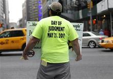 <p>A volunteer from the U.S. religious group Family Radio, a Christian radio network, holds a sign with warnings of an impending Judgment Day at Times Square in New York May 13, 2011. REUTERS/Shannon Stapleton</p>