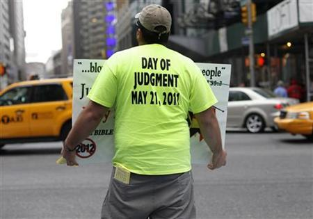 A volunteer from the U.S. religious group Family Radio, a Christian radio network, holds a sign with warnings of an impending Judgment Day at Times Square in New York May 13, 2011. REUTERS/Shannon Stapleton