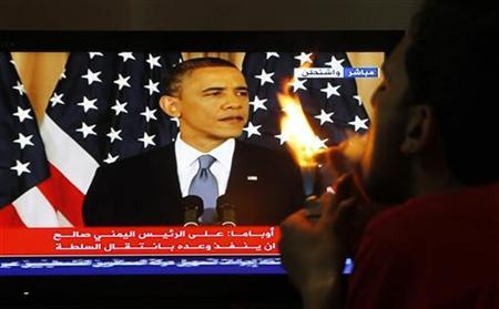 A Jordanian man watches a television broadcast of a speech by U.S. President Barack Obama in U.S., in Amman May 19, 2011. REUTERS/Ali Jarekji