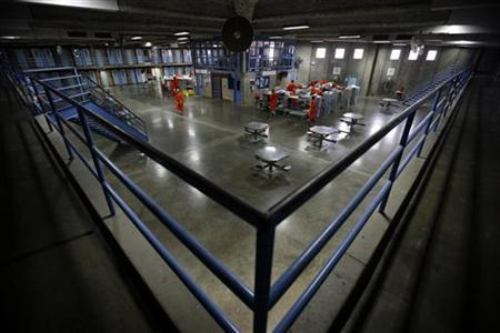 Prisoners at the Richard J. Donovan Correctional Facility in San Diego, California are seen housed in the dayroom of the prison due to overcrowding in the California prison system in this September 14, 2009 picture. REUTERS/Mike Blake