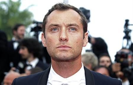 Jury member Jude Law arrives for the screening of the film ''Pirates Of The Caribbean: On Stranger Tides'' at the 64th Cannes Film Festival, May 14, 2011. REUTERS/Jean-Paul Pelissier