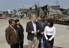 <p>Canadian Prime Minister Stephen Harper (C) answers questions at a news conference in downtown Slave Lake, Alberta, May 20, 2011. REUTERS/Todd Korol</p>