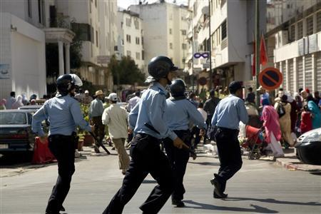 Policemen chase after demonstrators in Rabat May 22, 2011. Moroccan riot police chased hundreds of demonstrators defying a ban on protests through the streets of the capital Rabat on Sunday, suggesting a less tolerant approach to dissent in the North African monarchy. REUTERS/Adam Tanner