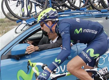 Movistar's Xavier Tondo of Spain speaks to his team director Jose Luis Arrieta during the 189,5 km sixth stage of the Tour of Catalunya cycling race in Mollet near Barcelona March 26, 2011. REUTERS/Gustau Nacarino