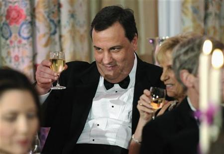 New Jersey Governor Chris Christie (C) shares a toast with his table mates as U.S. President Barack Obama (not pictured) plays host to a dinner for the National Governor's Association at the White House in Washington, February 27, 2011. REUTERS/Jonathan Ernst