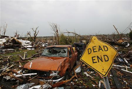 A sign lays among the ruins after a devastating tornado hit Joplin, Missouri May 23, 2011. REUTERS/Mike Stone
