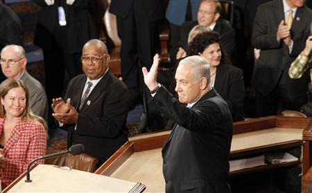Israeli Prime Minister Benjamin Netanyahu waves before beginning an address to a joint meeting of Congress in the House Chamber of the U.S. Capitol in Washington, May 24, 2011. REUTERS/Molly Riley