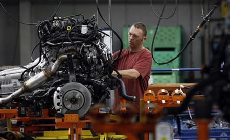 A Chrysler Group assembly worker works on the bottom chassis for Chrysler Jeeps, Grand Cherokees and Dodge Durangos at the Chrysler Jefferson North auto plant in Detroit, Michigan April 28, 2011. REUTERS/Rebecca Cook