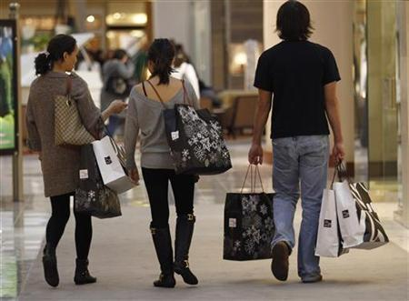 Shoppers carry their purchases during ''Black Friday'' at a high-end shopping mall in Tysons Corner, Virginia, November 26, 2010. REUTERS/Jason Reed
