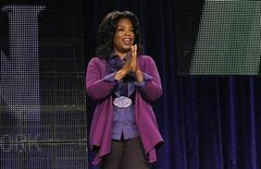 <p>Oprah Winfrey walks on stage for a panel during the Oprah Winfrey Network (OWN) Television Critics Association winter press tour in Pasadena, California January 6, 2011. REUTERS/Mario Anzuoni</p>