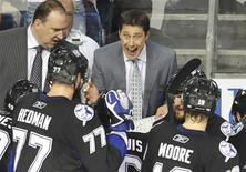 <p>Tampa Bay Lightning head coach Guy Boucher talks to his team during the second period in Game 6 of their NHL Eastern Conference Final hockey game against the Boston Bruins in Tampa, Florida, May 25, 2011. REUTERS/Steve Nesius</p>
