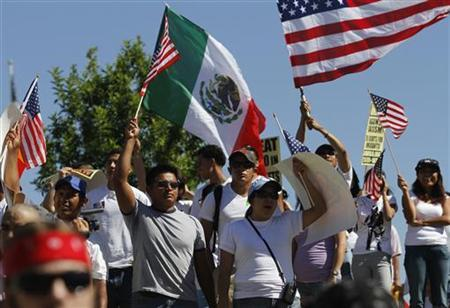 Demonstrators protest against Arizona's controversial immigration laws before marching to the State Capitol in Phoenix May 29, 2010. REUTERS/Joshua Lott