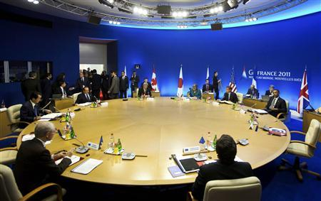 From L-R, G8 leaders, European Council President Herman Van Rompuy, Japanese Prime Minister Naoto Kan, Italian Prime Minister Silvio Berlusconi, Canadian Prime Minister Stephen Harper, German Chancellor Angela Merkel, French President Nicolas Sarkozy, President Barack Obama and European Commission President Jose Manuel Barroso are seen during a round table meeting at the G8 summit in Deauville, northern France May 26, 2011. REUTERS/Markus Schreiber/Pool
