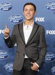 """<p>El cantante Scotty McCreery en la trastienda del programa """"American Idol"""" en Los Angeles, mayo 25 2011. El cantante de música country y voz grave Scotty McCreery ganó el miércoles la décima temporada de """"American Idol"""", venciendo a Lauren Alaina, quien había sido considerada como la favorita por los jueces del concurso de cara a la final. REUTERS/Mario Anzuoni</p>"""