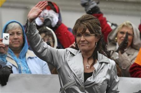 Sarah Palin waves to supporters and protesters following a speech at a Tax Day rally at the State Capitol in Madison, Wisconsin April 16, 2011. REUTERS/Allen Fredrickson