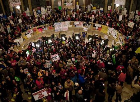 Protestors fill the rotunda outside of Wisconsin Governor Scott Walker's office while he holds a fireside chat at the state Capitol in Madison Wisconsin February 22, 2011. REUTERS/Darren Hauck