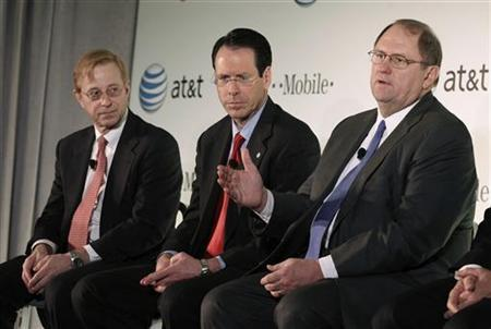 From right: Wayne Watts, Senior Executive Vice President and ATT&T General Counsel, Randall Stephenson, AT&T Inc. CEO, and Jim Cicconi, senior executive vice president-external and legislative affairs for AT&T, speak at a news conference to announce the company's proposal to buy T-Mobile USA from Deutsche Telekom in New York, March 21, 2011. REUTERS/Brendan McDermid