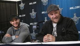<p>Vancouver Canucks' Kevin Bieksa (L) and team mate Sami Salo talk with media in Vancouver, British Columbia May 26, 2011. REUTERS/Andy Clark</p>