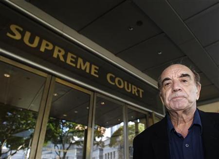 British author Alan Shadrake arrives at the Supreme Court in Singapore November 3, 2010. REUTERS/Vivek Prakash