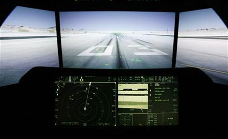 The F-35 cockpit of the world's newest fifth generation fighter aircraft is shown with a simulation demonstrator screen from a F-35 cockpit demonstrator at National Electronics Museum in Linthicum, Maryland, September 29, 2010. REUTERS/Hyungwon Kang