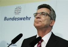 <p>German Defence Minister Thomas de Maiziere looks on before presenting his reform plans of the German armed forces to Bundeswehr officers at the Julius-Leber base in Berlin May 18, 2011. REUTERS/Thomas Peter</p>