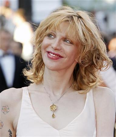 Singer Courtney Love arrives for the screening of the film ''This Must Be The Place'', in competition at the 64th Cannes Film Festival May 20, 2011. REUTERS/Jean-Paul Pelissier