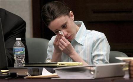 Casey Anthony wipes away tears at the start of the third day of her first degree murder trial at the Orange County Courthouse in Orlando, Florida May 26, 2011. REUTERS/Red Huber/Pool