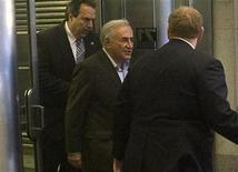 <p>Former IMF chief Dominique Strauss-Kahn leaves his temporary apartment at 71 Broadway where he is living under house arrest in New York, May 25, 2011. REUTERS/Allison Joyce</p>