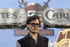 "<p>Cast member Johnny Depp poses at the premiere of ""Pirates of the Caribbean: On Stranger Tides"" at Disneyland in Anaheim, California May 7, 2011. REUTERS/Mario Anzuoni</p>"