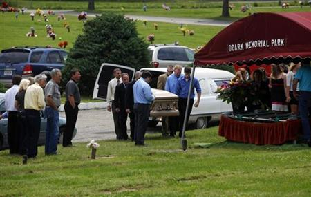 Pallbearers carry the casket of Lois Ada Comfort during her funeral in Webb City, Missouri May 30, 2011. Comfort was killed May 22, 2011 in a tornado in Joplin. REUTERS/Eric Thayer