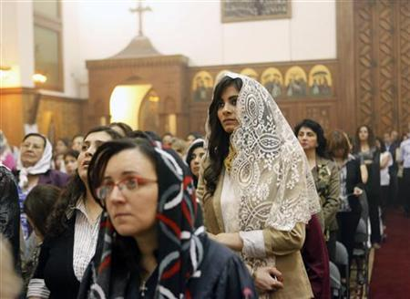 Coptic Orthodox Christians attend a mass as they celebrate Easter Sunday in a church in Cairo, April 23, 2011. REUTERS/Asmaa Waguih