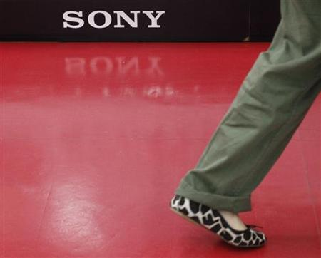 A customer walks past a logo of Sony Corp at an electronics store in Tokyo May 26, 2011. REUTERS/Toru Hanai