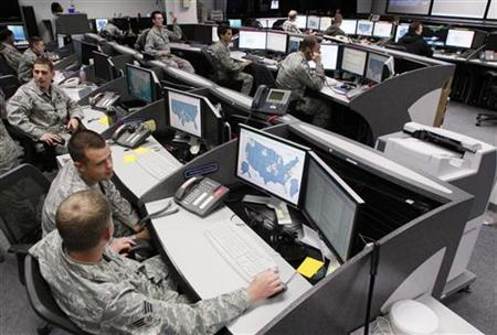 Personnel work at the Air Force Space Command Network Operations & Security Center at Peterson Air Force Base in Colorado Springs, Colorado July 20, 2010. REUTERS/Rick Wilking