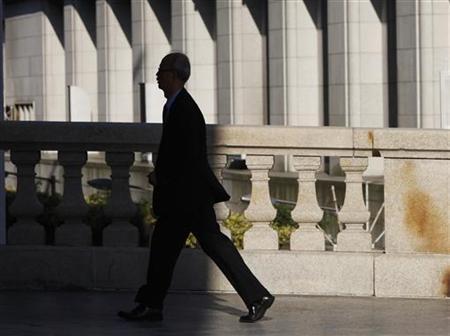 A man walks on a bridge at a financial district in Tokyo May 19, 2011. REUTERS/Yuriko Nakao