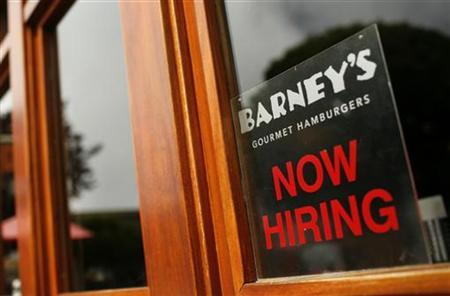 A sign in the window of a restaurant that is hiring is seen in San Francisco, California June 3, 2010. REUTERS/Robert Galbraith