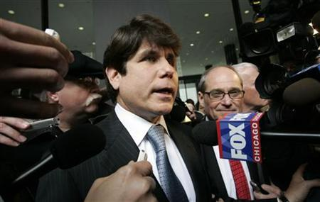 Former Illinois Governor Rod Blagojevich (L) speaks to the media as his attorney Sheldon Sorosky looks on as they leave the Dirksen federal building after his arraignment hearing in Chicago, Illinois April 14, 2009. REUTERS/Frank Polich