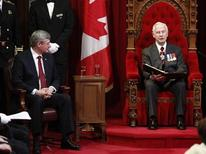 <p>Canada's Governor General David Johnston (R) delivers the Speech from the Throne as Canadian Prime Minister Stephen Harper (L) looks on in the Senate chamber on Parliament Hill in Ottawa June 3, 2011. REUTERS/Chris Wattie</p>