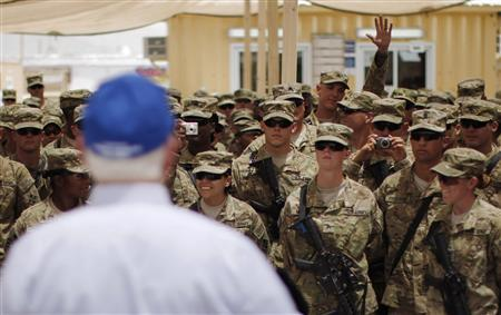 A soldier raises his hand to ask a question of U.S. Secretary of Defense Robert Gates during a question and answer session with troops at Forward Operating Base (FOB) Walton in Kandahar, Afghanistan, June 5, 2011. REUTERS/Jason Reed