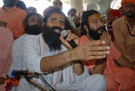 India's yoga guru Swami Ramdev speaks during a news conference in the northern Indian town of Haridwar June 5, 2011. REUTERS/Stringer